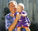 Photo of man holding grandchild